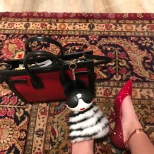 I was feeling a little Dorothy inspired. Shoes: Valentino. Handbag: Saint Laurent Paris. Bag Charm: Alice & Olivia